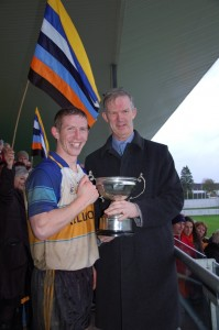 Trevor Phelan accepts the Intermediate Cup from Offaly Chairman Pat Teehan